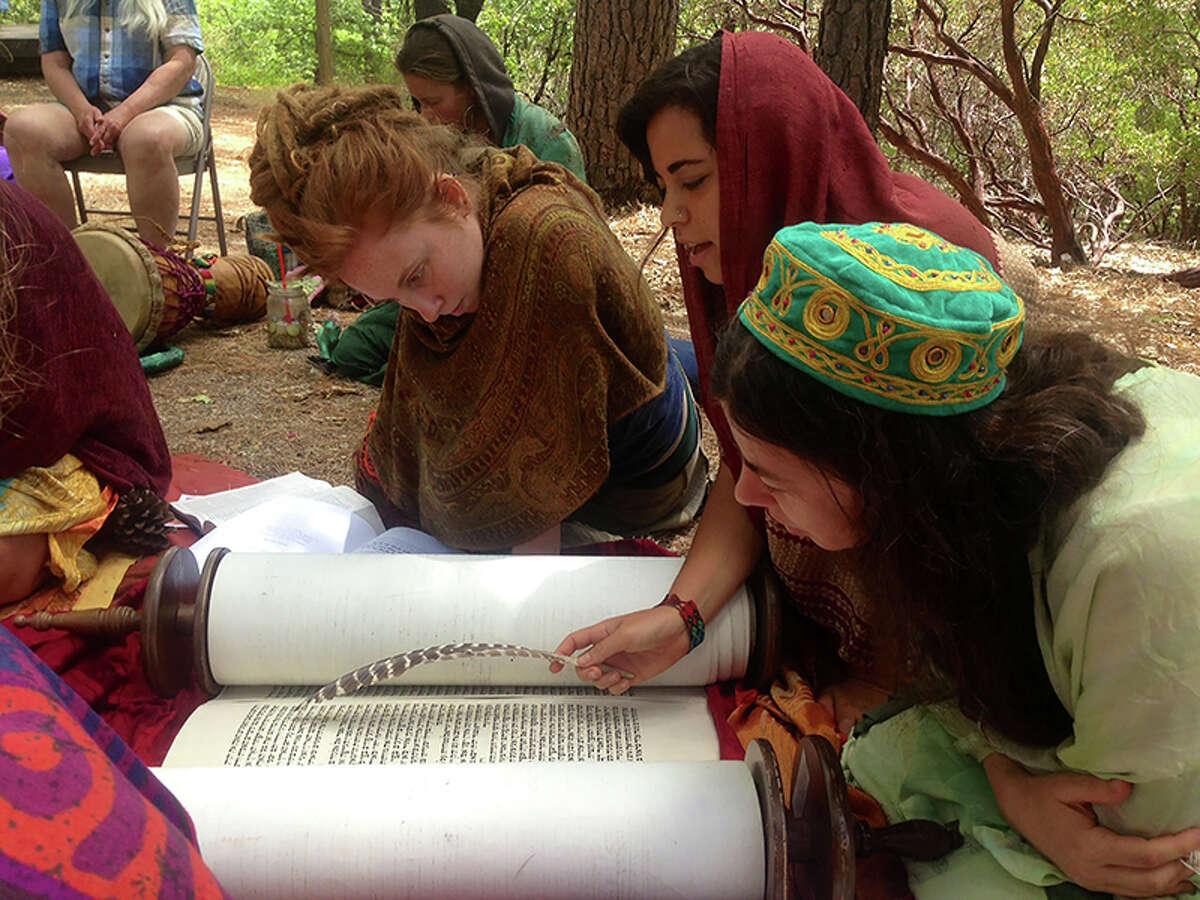 Yael Schonzeit chants from the Torah during a Kohenet training week in Northern California.