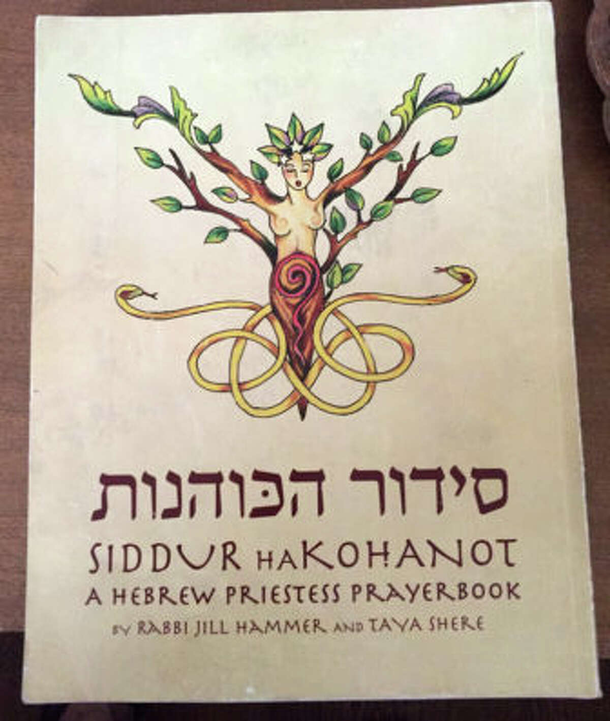 Priestess Rinah Rachel Galper uses the Hebrew Priestess Prayerbook during Shabbat services she conducts at her home. NOTE: Only available to RNS subscribers.