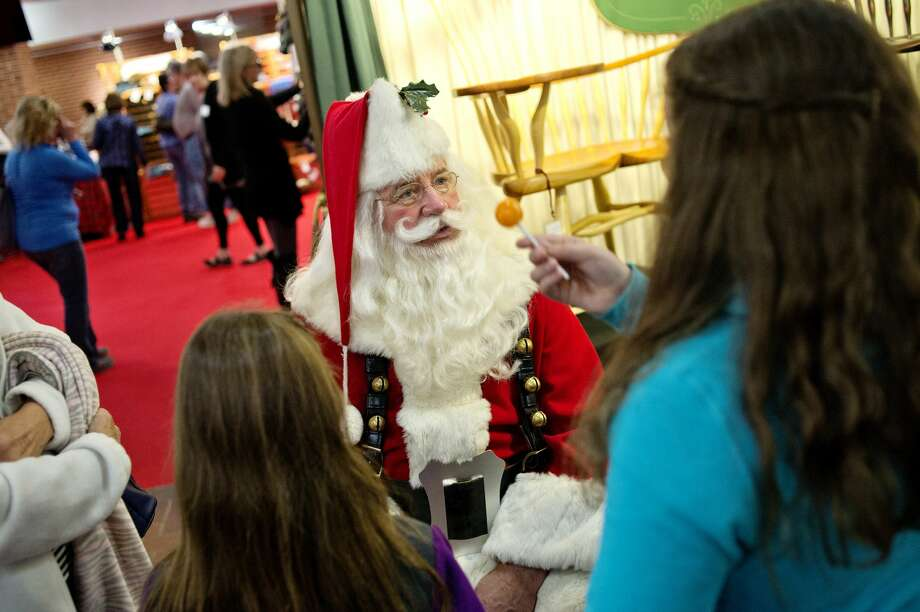 Santa visits with guests during the 37th Holiday Art Fair on Saturday at the Midland Center for the Arts. The fair, hosted by the Alden B. Dow Museum of Science and Art, featured many types of art including woodcrafts, sculptures, jewelry and painting. The annual event was held on Nov. 12 and 13. Photo: NICK KING | Nking@mdn.net