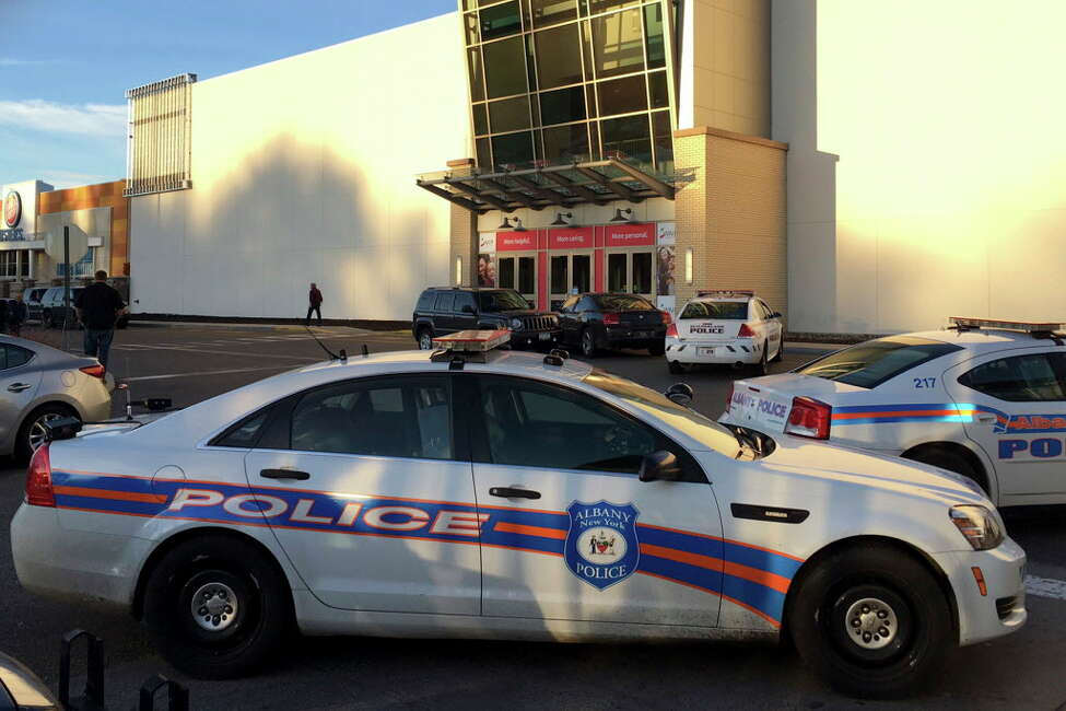 Police cars are positioned outside the Crossgates Mall in Guilderland, N.Y., while responding to reports of gunfire inside, Saturday, Nov. 12, 2016. The Albany Times-Union says hundreds of people were evacuated and the mall was locked down. (AP Photo/Michael Groll) ORG XMIT: NYR102