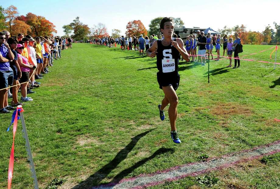 Staples' Zakeer Ahmad crosses the finish line in FCIAC Boys Cross Country Championship race action at Wavenly Park in New Canaan, Conn. on Wednesday Oct. 19, 2016. Photo: Christian Abraham / Hearst Connecticut Media / Connecticut Post