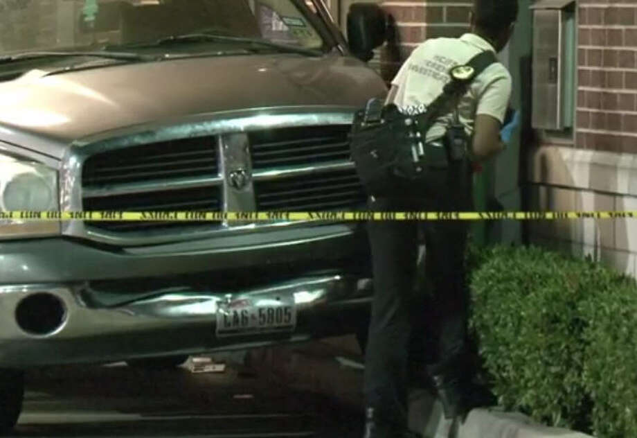 A bizarre accident at an ATM caused a man to be pinned between the wall and his truck Friday night in northwest Harris County. Officials say the man died at the scene. Photo: Metro Video