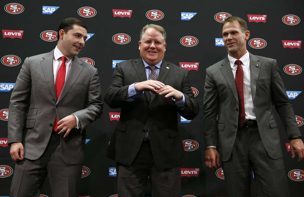 San Francisco 49ers CEO Jed York, Chip Kelly and general manager Trent Baalke smile after Kelly is introduced as the team's new head coach at a news conference at Levi's Stadium in Santa Clara, Calif. on Wednesday, Jan. 20, 2016.
