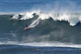 A group of surfers including Bianca Valenti, (right)take off on a wave at the Mavericks break in Half Moon Bay, California, on Friday November 4, 2016