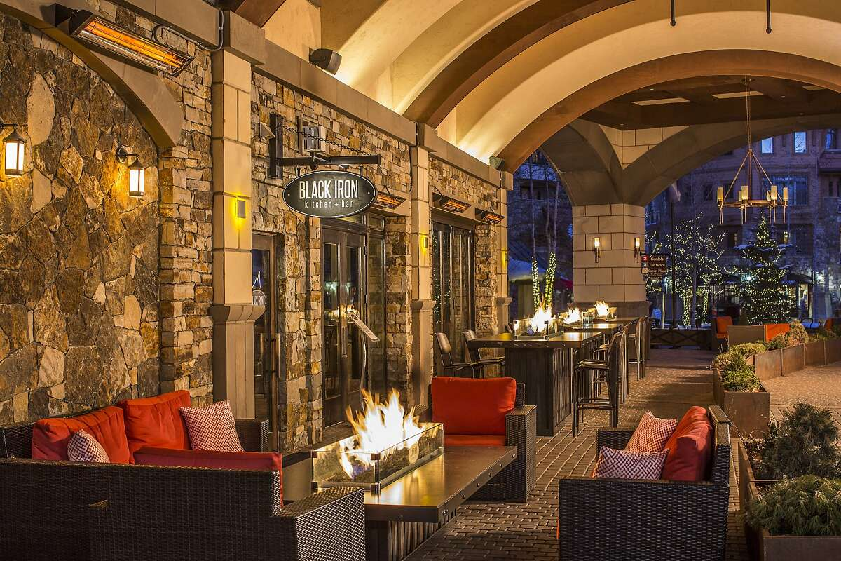 Next to the skating rink in Mountain Village, Colo., the Madeline Hotel and Residences� indoor-outdoor, casual Black Iron Kitchen & Bar restaurant keeps al fresco diners warm with fire tables.