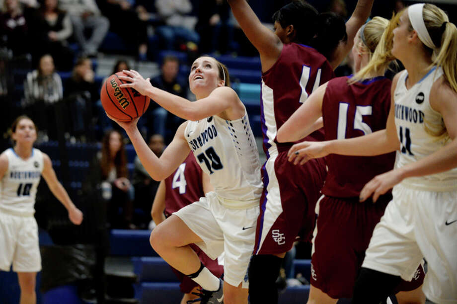 NICK KING | nking@mdn.net  Northwood's Lindsay Orwat, left, shoots as Saint Joseph's Kalea Parks defends during the second quarter on Saturday at Northwood University. The Timberwolves won 64-58. / Midland Daily News