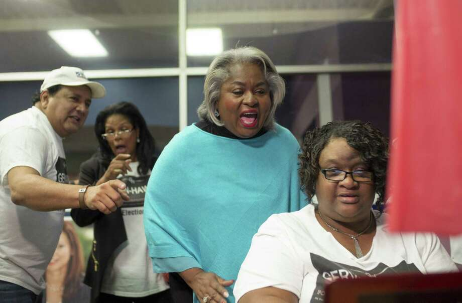 Barbara Gervin-Hawkins, second from right, celebrates a large lead in voting returns with supporters Margaret Richardson, right, Ramon Chapa, Jr., left, and Zarinah Shakir during an election night event, Tuesday, Nov. 8, 2016, at her campaign headquarters in San Antonio. (Darren Abate/For the Express-News) Photo: Darren Abate, FRE / Darren Abate/San Antonio Express-News / DarrenAbateMedia