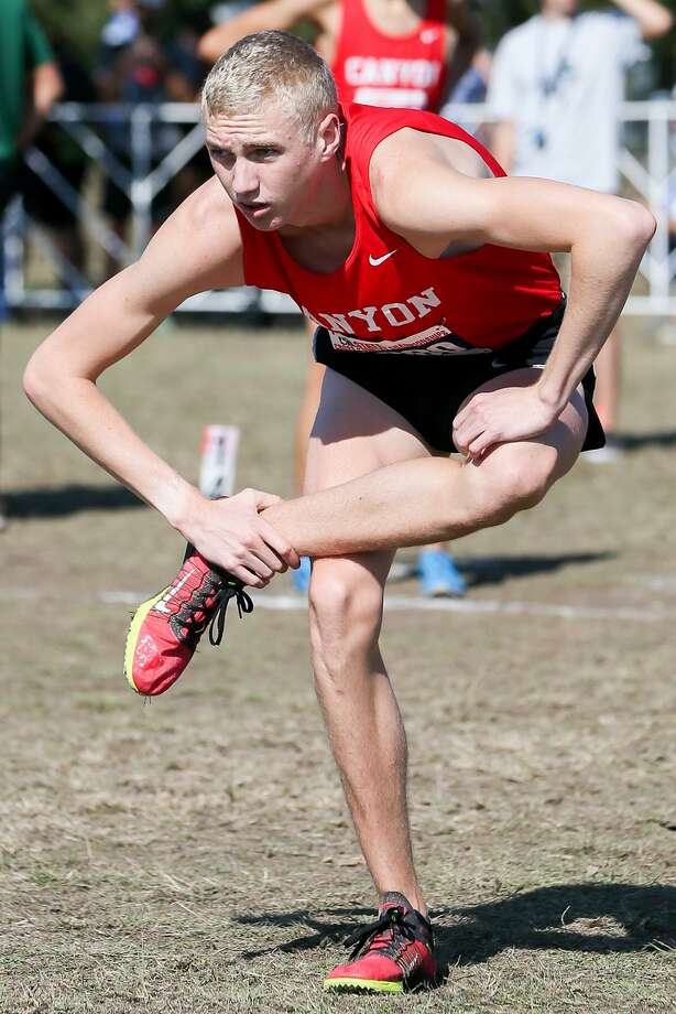 New Braunfels Canyon's Sam Worley stretches prior to the start of the 6A boys 5K during the UIL cross country state meet at Settlers Park in Round Rock on Saturday, Nov. 12, 2016.  Worley won the event with a time of 14:40.82.  MARVIN PFEIFFER/ mpfeiffer@express-news.net Photo: Marvin Pfeiffer, Staff / San Antonio Express-News / Express-News 2016