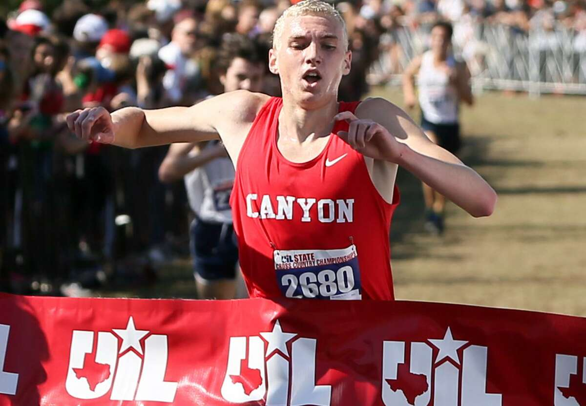 New Braunfels Canyon's Sam Worley crosses the finish line of the 6A boys 5K during the UIL cross country state meet at Old Settlers Park in Round Rock on Nov. 12, 2016. Worley won the event with a time of 14:40.82.