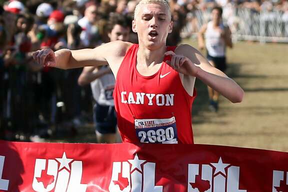 New Braunfels Canyon's Sam Worley crosses the finish line of the 6A boys 5K during the UIL cross country state meet at Settlers Park in Round Rock on Nov. 12, 2016. Worley won the event with a time of 14:40.82.