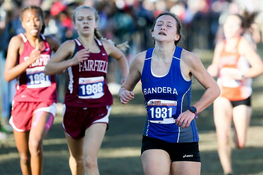 Bandera's Ashlyn Persyn crosses the finish line of the 4A girls 3,200-meter run during the UIL cross country state meet at Old Settlers Park in Round Rock on Nov. 12, 2016. Photo: Marvin Pfeiffer /San Antonio Express-News / Express-News 2016