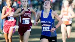 Bandera's Ashlyn Persyn crosses the finish line of the 4A girls 3,200-meter run during the UIL cross country state meet at Old Settlers Park in Round Rock on Nov. 12, 2016.