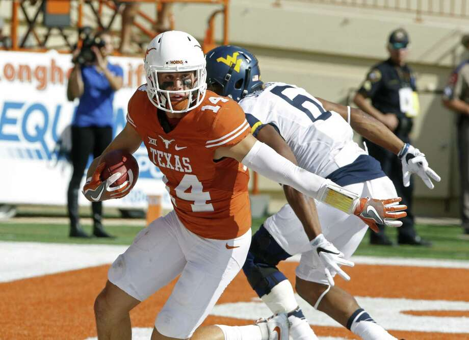 Texas safety Dylan Haines (14) intercepts a pass intended for West Virginia's Daikiel Shorts, Jr. (6) in the end zone during the second half of an NCAA college football game against West Virginia, Saturday, Nov. 12, 2016, in Austin, Texas. West Virginia won 24-20. (AP Photo/Michael Thomas) Photo: Michael Thomas, FRE / Associated Press / FR65778 AP