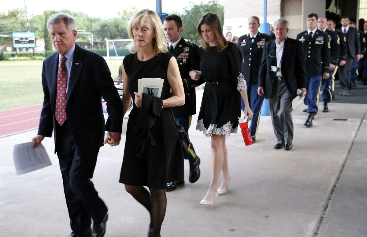 Family members of Jimmy Moriarty, U.S. Army Special Forces soldier who was killed in Jordan last week, followed by army members leaving the Annunciation Orthodox School gym after the memorial service Saturday, Nov. 12, 2016, in Houston. Among them are Moriarty's father, James Moriarty, left, and older sister, Rebecca Moriarty, fourth from left.