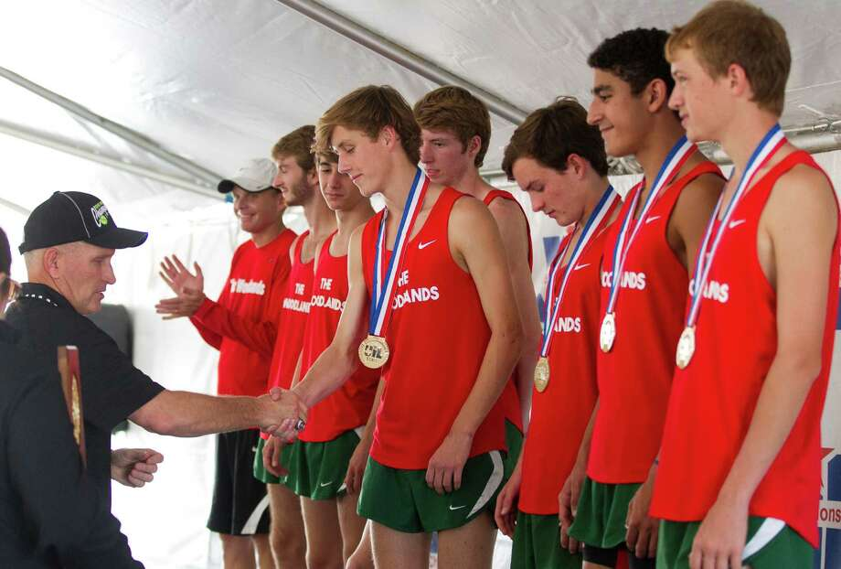The Woodlandsé• varsity boys team receives their medals after taking the first place team title during the UIL state cross country championships at Old Settlers Park Saturday, Nov. 12, 2016, in Round Rock. Photo: Jason Fochtman, Staff Photographer / Houston Chronicle