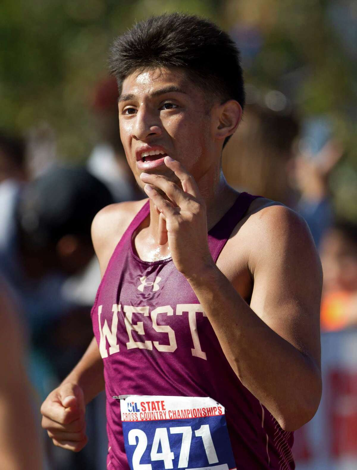Jonathan Gomez, of Magnolia West, competes in the Class 5A boys race during the UIL state cross country championships at Old Settlers Park Saturday, Nov. 12, 2016, in Round Rock.