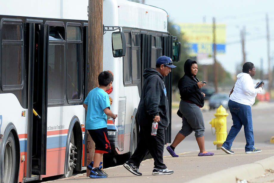Passengers disembark from EZ Rider busses at the downtown stop located at N. Weatherford and E. Texas Ave on Saturday, Nov. 12, 2016. James Durbin/Reporter-Telegram Photo: James Durbin