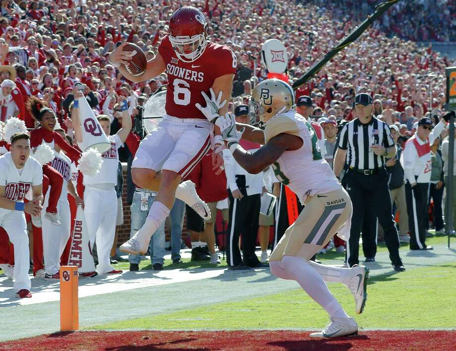 Oklahoma quarterback Baker Mayfield (6) runs in for a touchdown ahead of Baylor safety Davion Hall (2) during the first half of an NCAA college football game in Norman, Okla. on Saturday, Nov. 12, 2016. (AP Photo/Alonzo Adams) Photo: Alonzo Adams, FRE / FR159426 AP