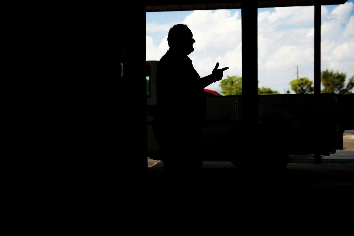 Kelview Heights Baptist Church pastor Jeff Franklin looks out a door of the church to parking lot they just purchased, adding to the 10-acres of land that they own and recently leased the mineral rights to an oil company looking to drill under the city of Midland Thursday, Sept. 15, 2016. ( Michael Ciaglo / Houston Chronicle )