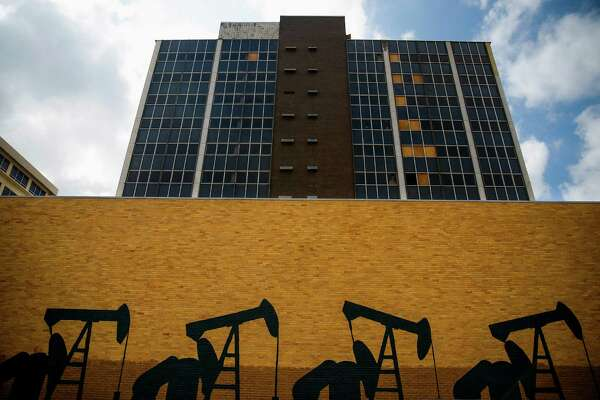 A mural of pumpjacks is painted on a wall in downtown Midland Thursday, Sept. 15, 2016. ( Michael Ciaglo / Houston Chronicle )