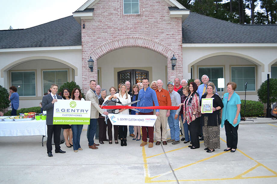 S. Gentry Custom Homes and the Conroe/Lake Conroe Chamber of Commerce celebrate the grand opening in Willis. Photo: Submitted