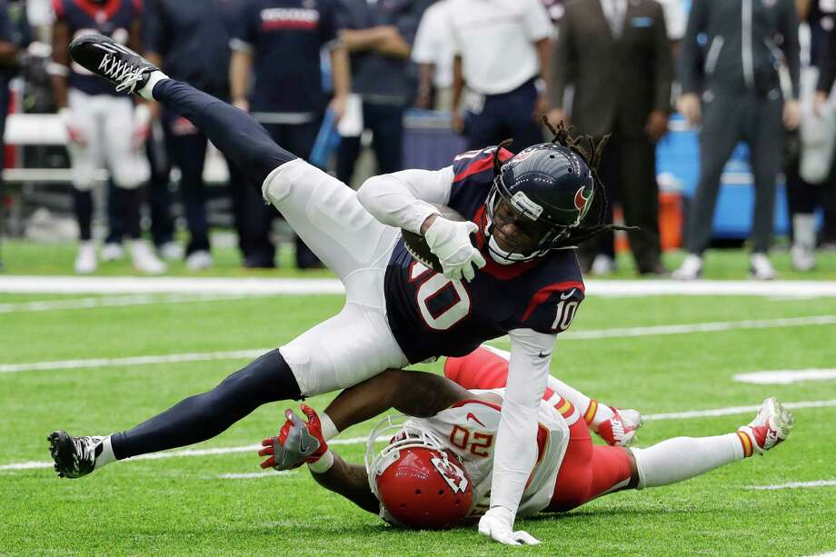 """FILE - In this Sept. 18, 2016, file photo, Houston Texans wide receiver DeAndre Hopkins (10) is upended by Kansas City Chiefs cornerback Steven Nelson (20) during the second half of an NFL football game in Houston. The Texans have been dreadful on the road this season, losing lopsided games at New England, Minnesota and Denver. """"You got to put the bad games behind you and move on,"""" Texans receiver DeAndre Hopkins said. The Texans play at Jacksonville on Sunday.  (AP Photo/David J. Phillip, File) Photo: David J. Phillip, STF / Copyright 2016 The Associated Press. All rights reserved."""