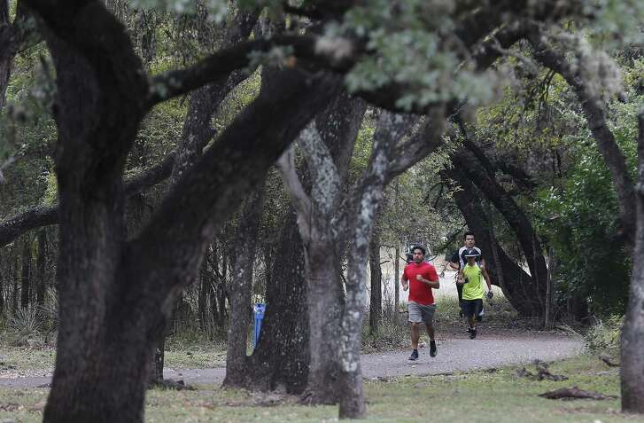 Participants in a Crossfit class lead by instructor Michael Jones run along a path during a workout session at McAllister Park Nov. 5, 2016. The workout is one of many fitness outreach efforts offered by the City of San Antonio. About 10 men and women gathered on a Saturday to workout under Jones' guidance.