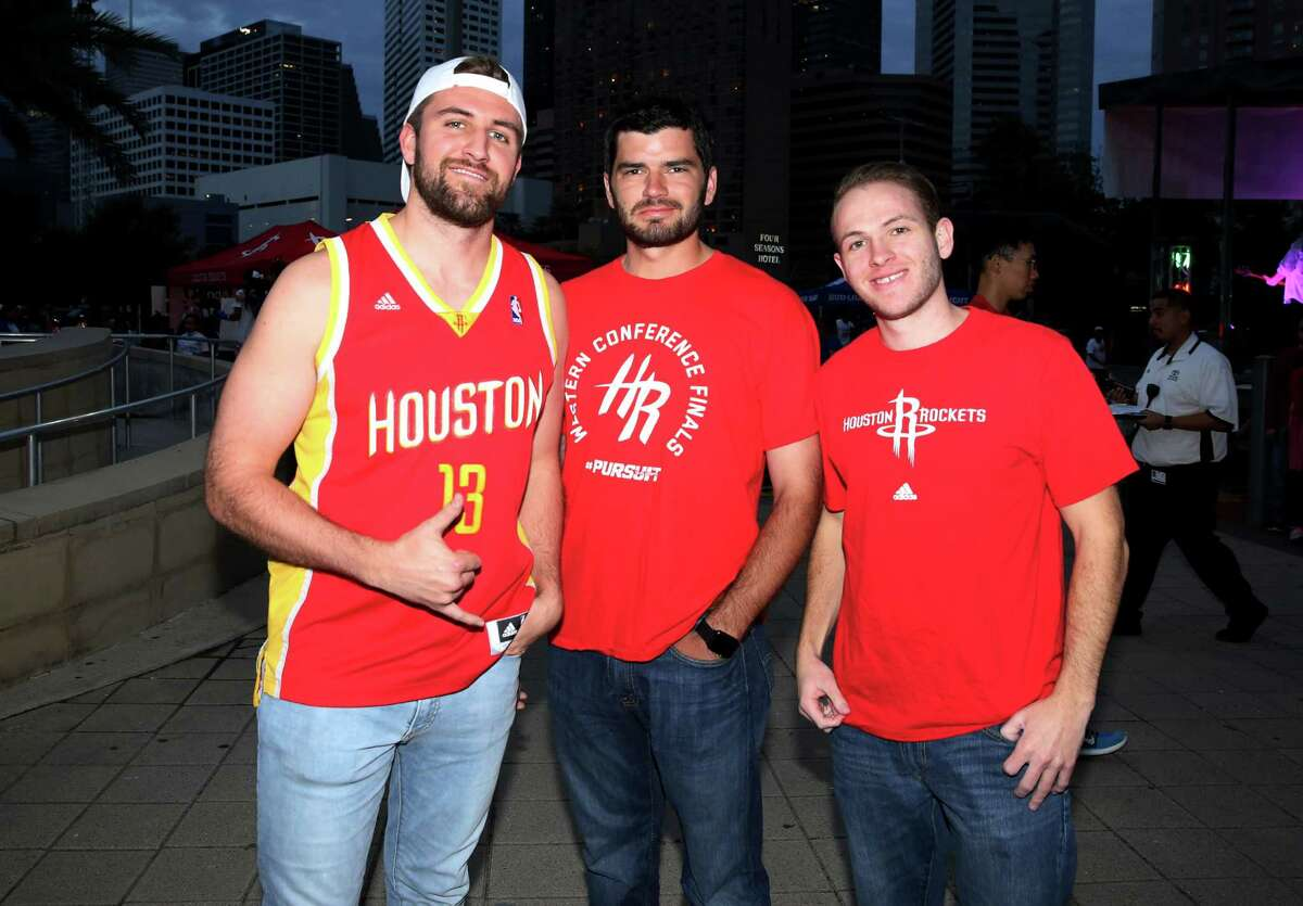 Fans pose for a photo outside Toyota Center before the Houston Rockets takes on San Antonio Spurs Saturday, Nov. 12, 2016, in Houston.