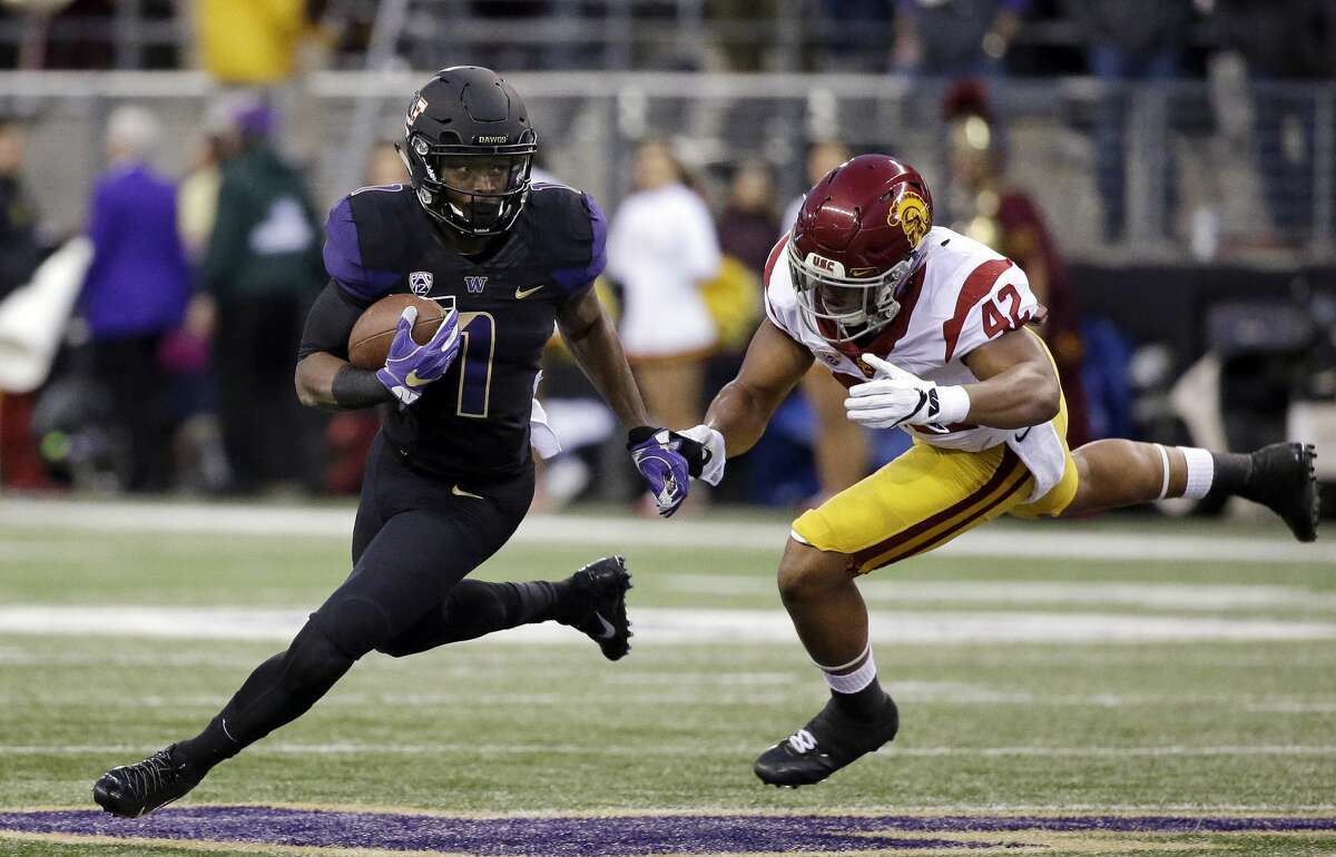 14. 2016 blackout alternate Dear lord Nike, why? To be edgy? To (gulp) bite Oregon's style? I'm not sure there was ever a good reason to give UW an all-black kit, but these might have worked without those sleeves...but then they wouldn't really be Washington jerseys. So we get the purple sleeves. It wouldn't be a shock if this jersey made the decision to jump to Adidas easier.