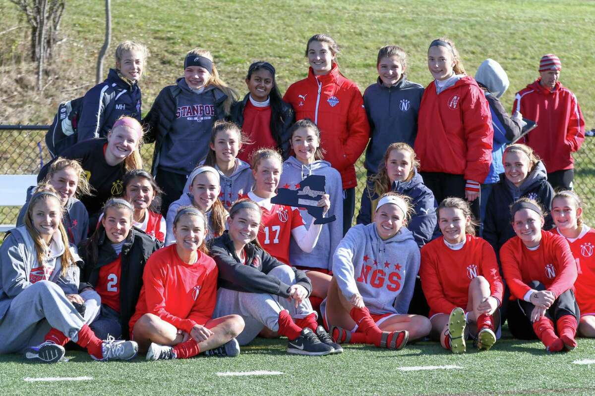 The Niskayuna girls' soccer team poses with its consolation plaque after falling to Massapequa 3-1 in the state semifinals at Tompkins-Cortland Community College on Saturday, Nov. 12, 2016. (Robert Dungan / Special to the Times Union)