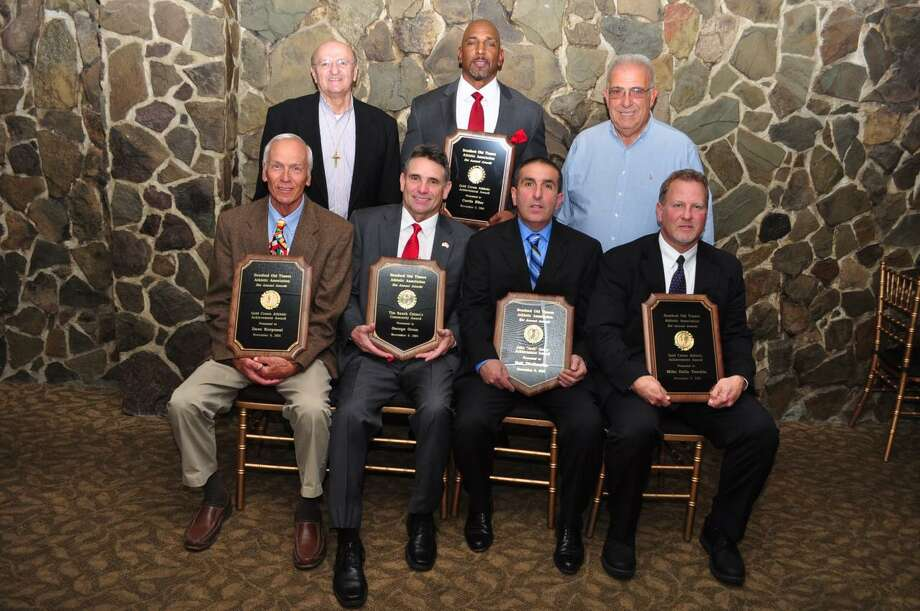 """The Stratford Old Timers held their annual awards dinnder on Wednesday at Vazzano's Four Seasons in Stratford. Sitting, from left, Golden Crown Award, Dave Karponai (Golden Crown Award); George Grom (Tim Ramik Citizen Commuity Award); Neil Dinihanian(John """"Jack"""" Geary Award); Mike Della Vecchia (Golden Crown Award); standing, from left, Deacon Frank Masso; Curtis Eller (Golden Crown Award) and dinner chairman Ron Fiorella. Photo: Contributed Photo / Connecticut Post Contributed"""