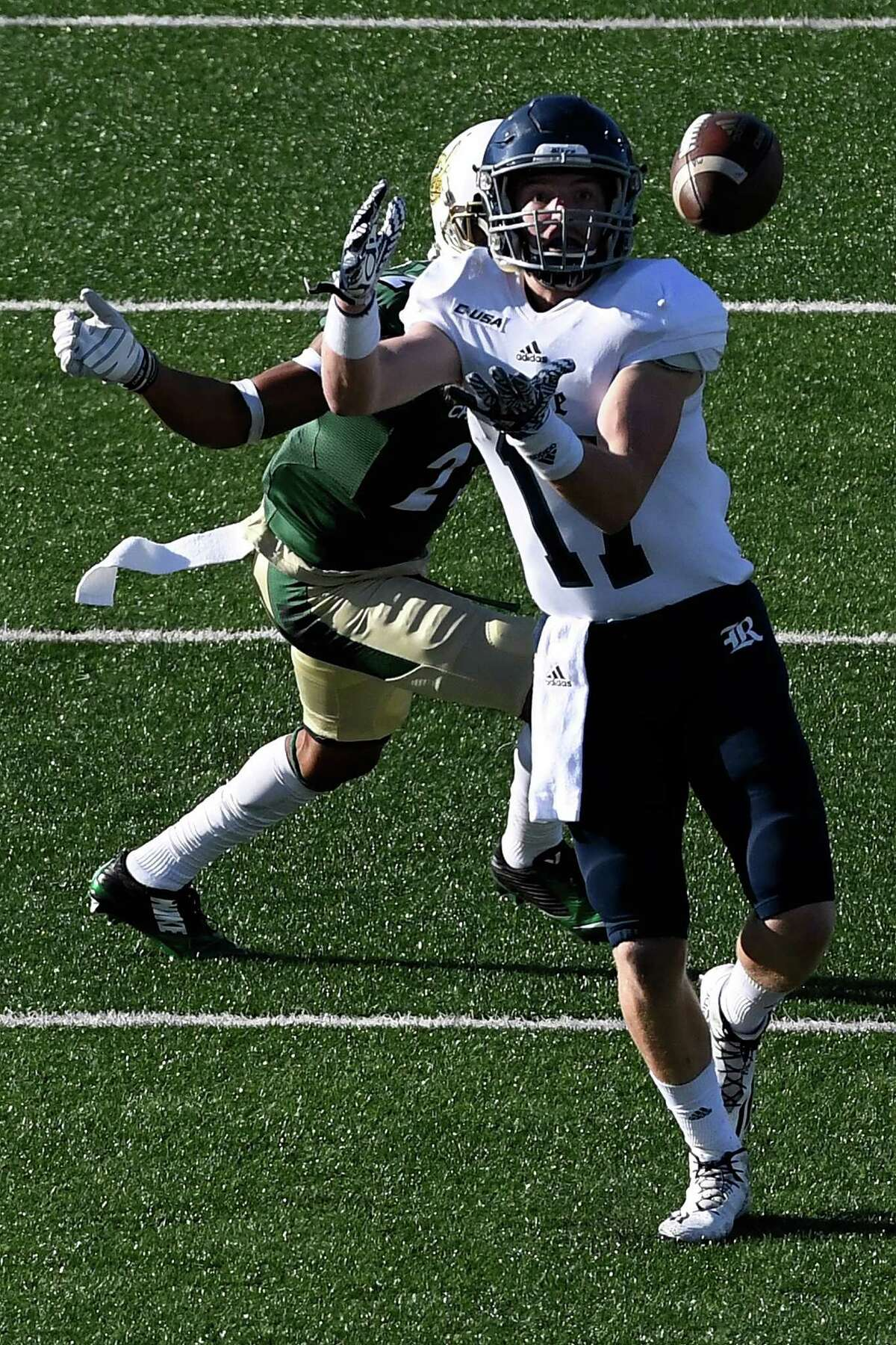 CHARLOTTE, NC - NOVEMBER 12: Wide receiver Zach Wright #17 of the Rice Owls tracks in a pass against the Charlotte 49ers at McColl-Richardson Field at Jerry Richardson Stadium on November 12, 2016 in Charlotte, North Carolina.