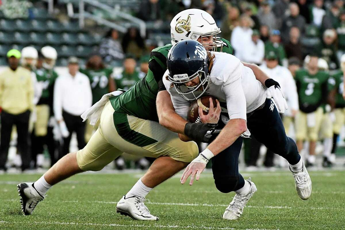 CHARLOTTE, NC - NOVEMBER 12: Defensive lineman Nick Carroll #91 of the Charlotte 49ers tackles quarterback Tyler Stehling #10 of the Rice Owls at McColl-Richardson Field at Jerry Richardson Stadium on November 12, 2016 in Charlotte, North Carolina.
