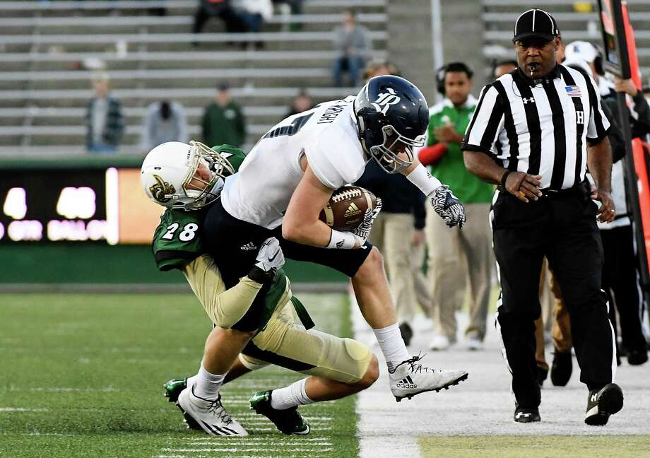 CHARLOTTE, NC - NOVEMBER 12:  Defensive back Ben DeLuca #28 of the Charlotte 49ers forces wide receiver Zach Wright #17 of the Rice Owls out of bounds at McColl-Richardson Field at Jerry Richardson Stadium on November 12, 2016 in Charlotte, North Carolina. Photo: Mike Comer, Getty Images / 2016 Getty Images