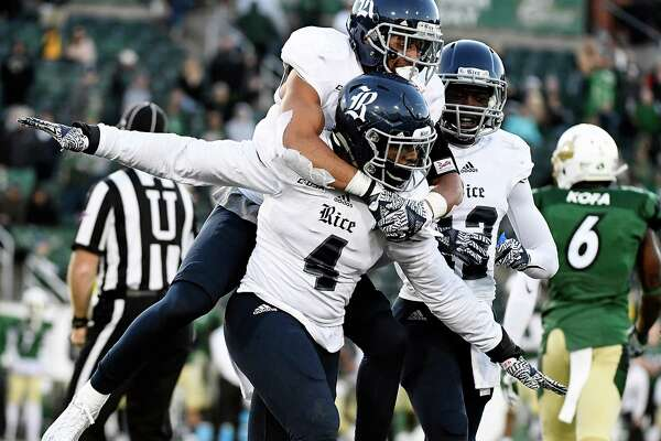 CHARLOTTE, NC - NOVEMBER 12:  Linebacker Alex Lyons #4 of the Rice Owls carries cornerback V.J. Banks #19 in celebration after a game-winning stop against the Charlotte 49ers at McColl-Richardson Field at Jerry Richardson Stadium on November 12, 2016 in Charlotte, North Carolina.