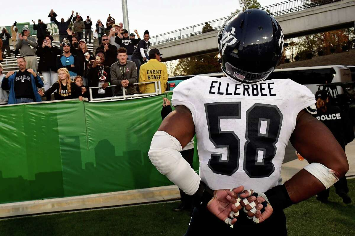 CHARLOTTE, NC - NOVEMBER 12: Linebacker Emmanuel Ellerbee #58 of the Rice Owls stirs up the Rice crowd at the McColl-Richardson Field at Jerry Richardson Stadium following the Owls' victory over the Charlotte 49ers on November 12, 2016 in Charlotte, North Carolina.