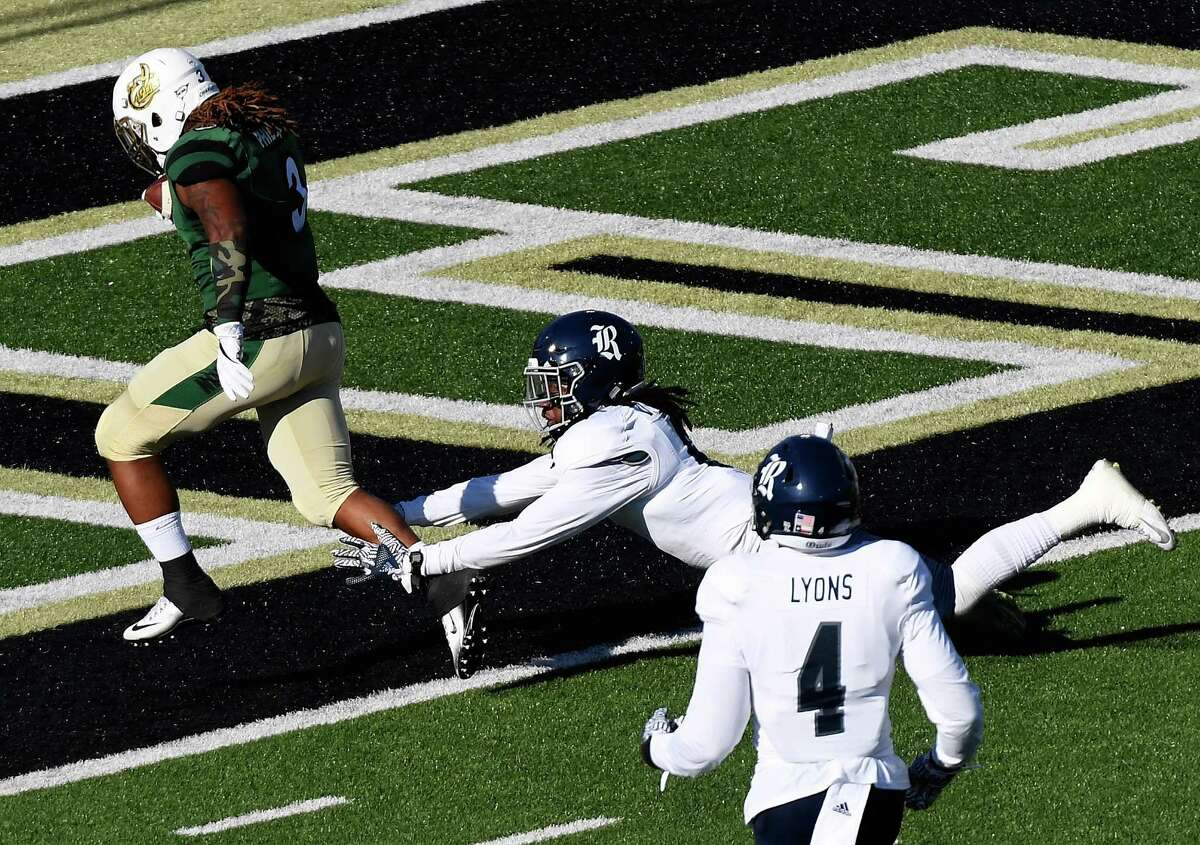 CHARLOTTE, NC - NOVEMBER 12: Running back Kalif Phillips #3 of the Charlotte 49ers scores a touchdown against the Rice Owls at McColl-Richardson Field Field at Jerry Richardson Stadium on November 12, 2016 in Charlotte, North Carolina.