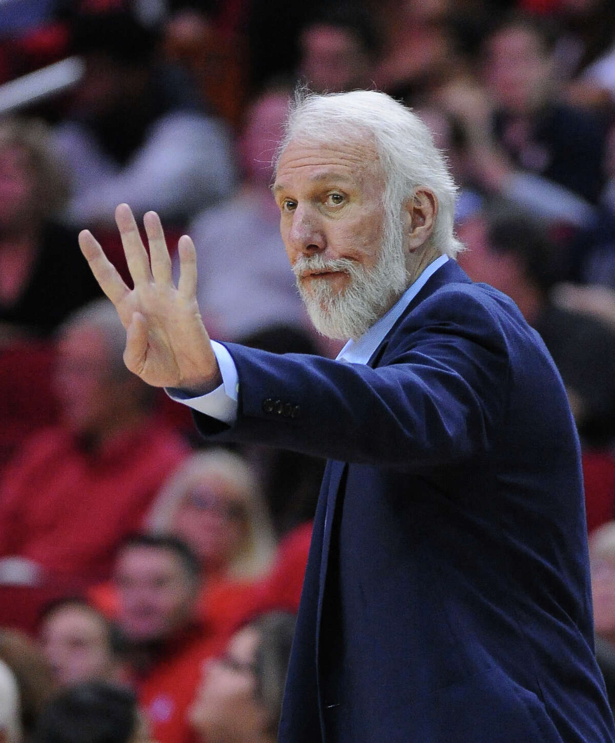 San Antonio Spurs head coach Gregg Popovich calls a play as his team faces the Houston Rockets in the first half of an NBA basketball game on Saturday, Nov. 12, 2016, in Houston. (AP Photo/George Bridges)