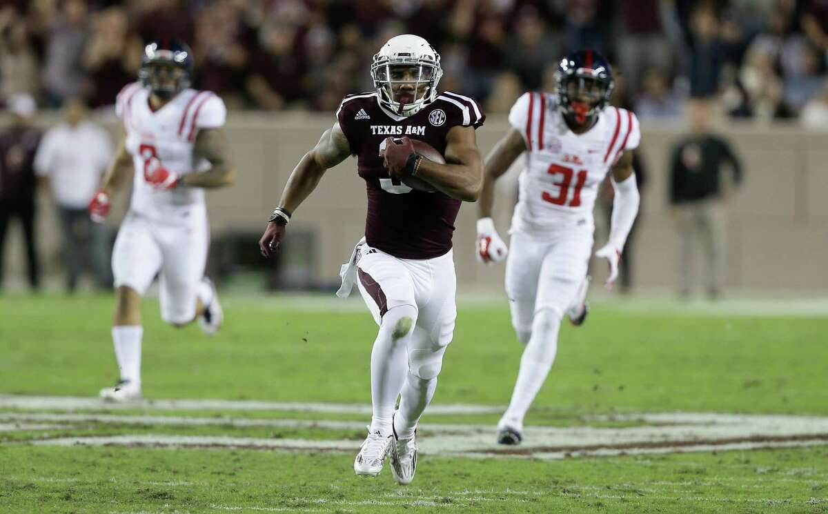 COLLEGE STATION, TX - NOVEMBER 12: Christian Kirk #3 of the Texas A&M Aggies runs for a large gain after catching a pass in the first quarter as Jaylon Jones #31 of the Mississippi Rebels pursues at Kyle Field on November 12, 2016 in College Station, Texas.