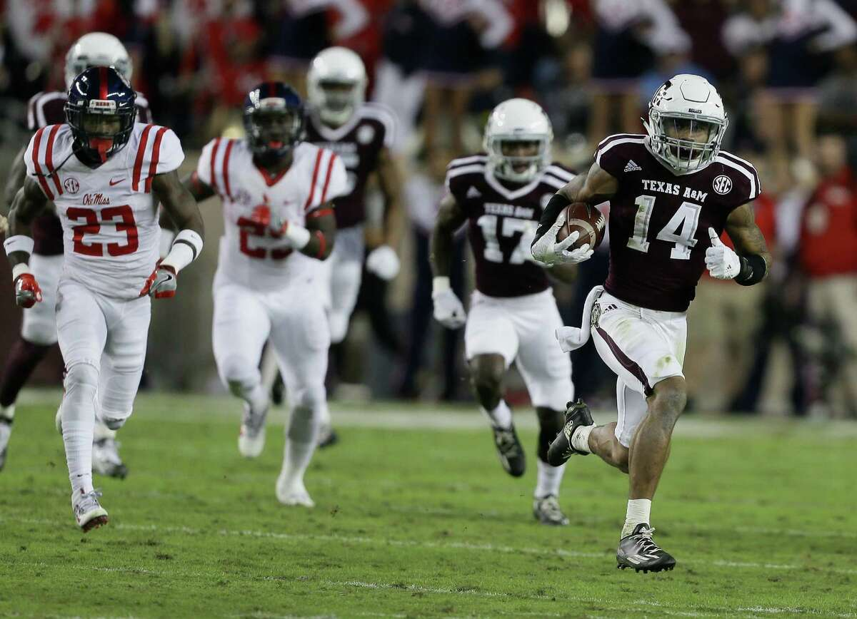 COLLEGE STATION, TX - NOVEMBER 12: Justin Evans #14 of the Texas A&M Aggies returns a kickoff 90 yards in the second quarter as Carlos Davis #23 of the Mississippi Rebels pursues at Kyle Field on November 12, 2016 in College Station, Texas.