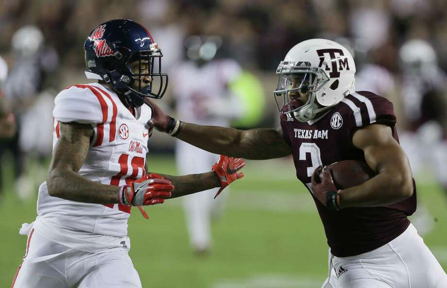 COLLEGE STATION, TX - NOVEMBER 12:  Christian Kirk #3 of the Texas A&M Aggies gives Derrick Jones #19 of the Mississippi Rebels a stiff arm at Kyle Field on November 12, 2016 in College Station, Texas. Photo: Bob Levey, Getty Images / 2016 Getty Images