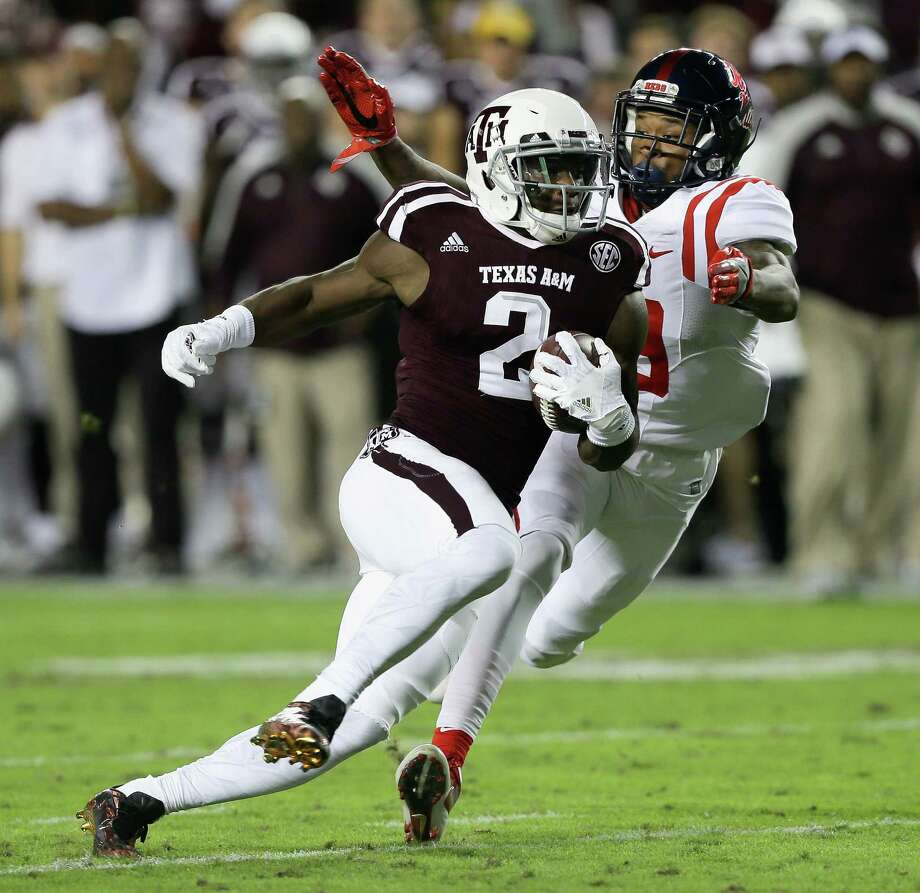 COLLEGE STATION, TX - NOVEMBER 12:  Speedy Noil #2 of the Texas A&M Aggies runs past Derrick Jones #19 of the Mississippi Rebels at Kyle Field on November 12, 2016 in College Station, Texas. Photo: Bob Levey, Getty Images / 2016 Getty Images