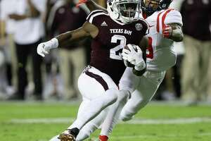 COLLEGE STATION, TX - NOVEMBER 12:  Speedy Noil #2 of the Texas A&M Aggies runs past Derrick Jones #19 of the Mississippi Rebels at Kyle Field on November 12, 2016 in College Station, Texas.