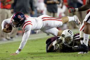Mississippi quarterback Jason Pellerin (7) dives for yardage after a short gain against Texas A&M during the first quarter of an NCAA college football game Saturday, Nov. 12, 2016, in College Station, Texas. (AP Photo/Sam Craft)