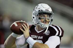 COLLEGE STATION, TX - NOVEMBER 12:  Jake Hubenak #10 of the Texas A&M Aggies wrms up before playing Mississippi Rebels at Kyle Field on November 12, 2016 in College Station, Texas.