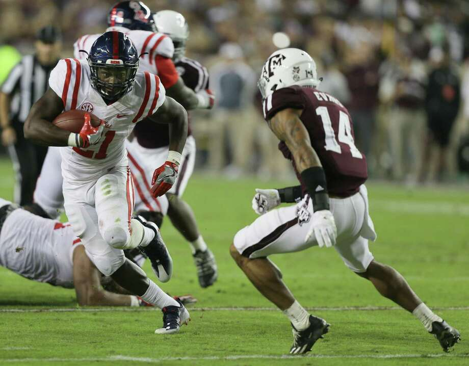 COLLEGE STATION, TX - NOVEMBER 12:  Akeem Judd #21 of the Mississippi Rebels runs past Justin Evans #14 of the Texas A&M Aggies at Kyle Field on November 12, 2016 in College Station, Texas.  (Photo by Bob Levey/Getty Images) Photo: Bob Levey, Stringer / Getty Images / 2016 Getty Images