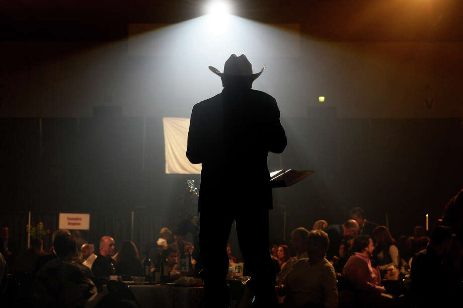 Auctioneer Scott Droddy leads the live auction at the American Cancer Society's Southeast Texas Cattle Baron's Ball at the Beaumont Civic Center on Saturday night. The event sold out at 1,000 tickets. Photo taken Saturday 11/12/16 Ryan Pelham/The Enterprise Photo: Ryan Pelham / ©2016 The Beaumont Enterprise/Ryan Pelham
