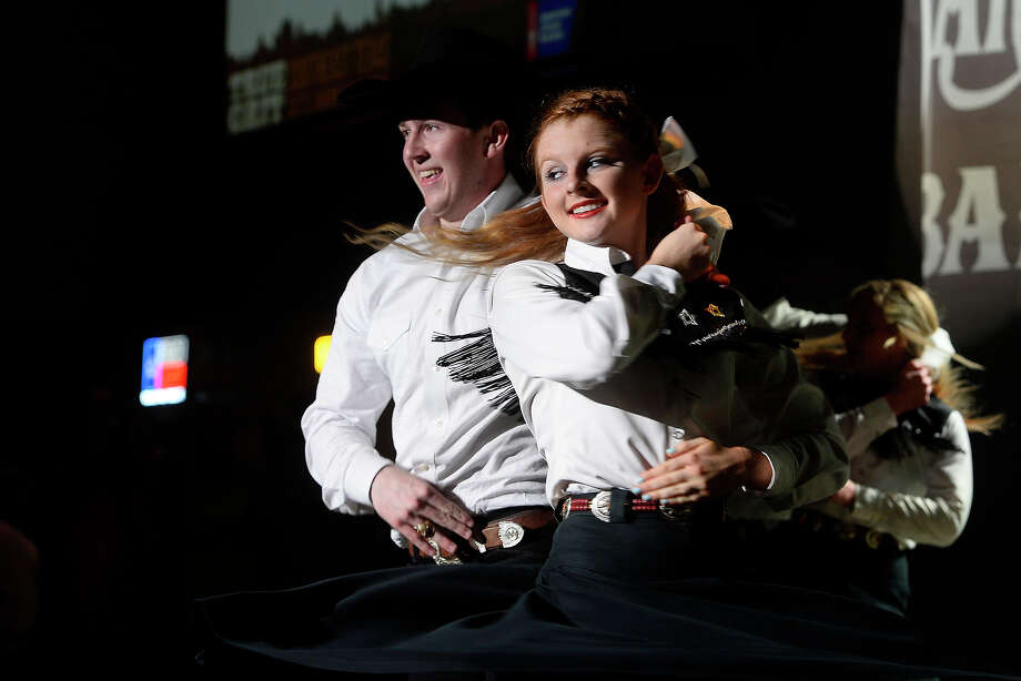 Members of Texas A&M University's Aggie Wranglers western dance group perform at the American Cancer Society's Southeast Texas Cattle Barron's Ball at the Beaumont Civic Center on Saturday night. The event sold out at 1,000 tickets. Photo taken Saturday 11/12/16 Ryan Pelham/The Enterprise Photo: Ryan Pelham / ©2016 The Beaumont Enterprise/Ryan Pelham
