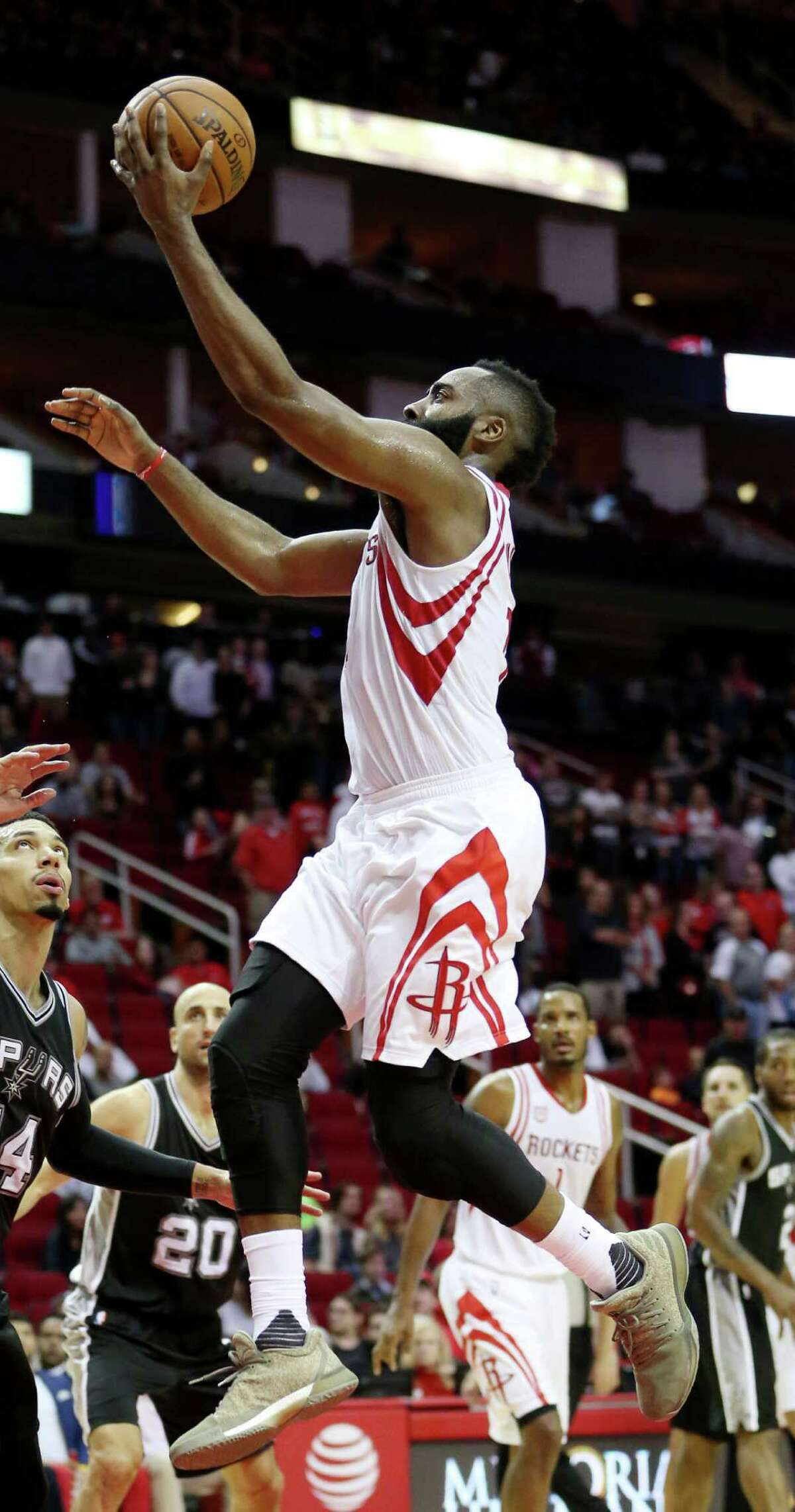 Houston Rockets guard James Harden (13) goes for a lay up during the second half of the game Saturday, Nov. 12, 2016, in Houston. The Rockets lost to the Spurs 106-100.