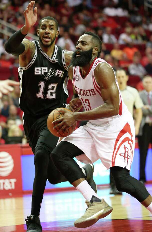 Houston Rockets guard James Harden (13) drives to the basket while San Antonio Spurs forward LaMarcus Aldridge (12) is guarding him during the second half of the game Saturday, Nov. 12, 2016, in Houston. The Rockets lost to the Spurs 106-100. Photo: Yi-Chin Lee, Houston Chronicle / © 2016  Houston Chronicle
